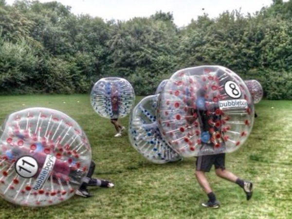 people in essex playing zorb and bubble football