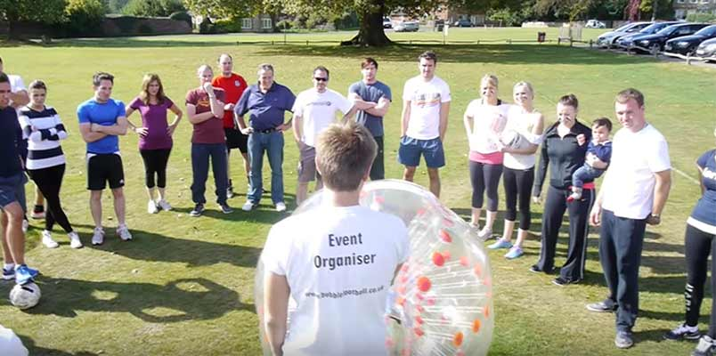 A event organiser showing the rules of bubble football in the UK