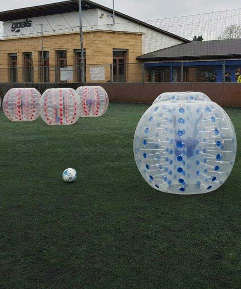 People playing zorb football on an AstroTurf pitch in the UK