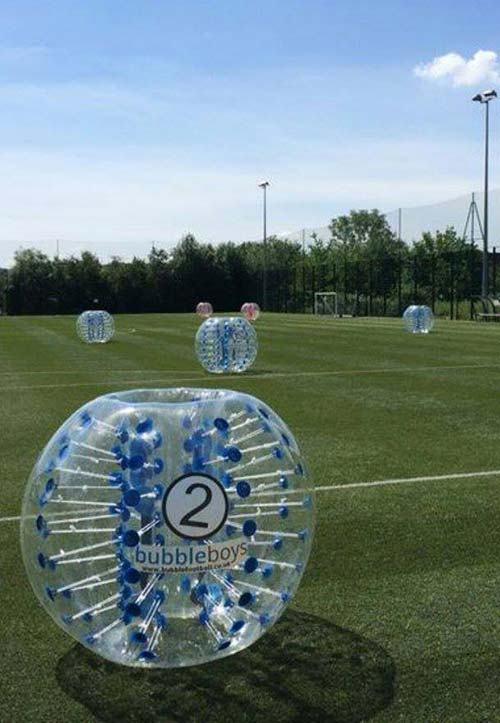 6 giant bubble zorbs on a football pitch in London